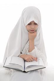 stock photo of islamic religious holy book  - Pretty Muslim Girl Reading Holy Book of Quran Isolated on White Background - JPG
