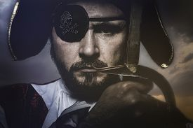 foto of pirate sword  - pirate with hat and eye patch holding a sword - JPG