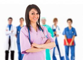 pic of nursing  - Young smiling nurse in front of her medical team - JPG