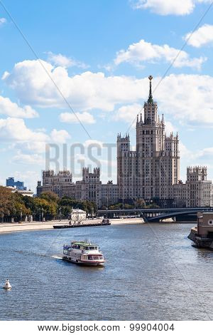 Boat In Moskva River And Tall Building In Moscow