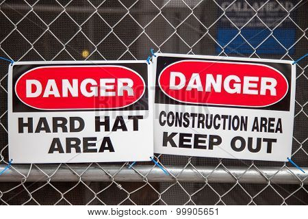 Construction site signs on fence