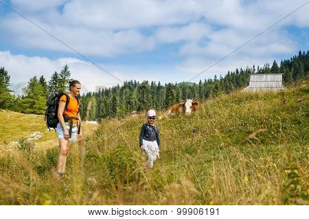 Mother And Daughter On A Mountain Hike