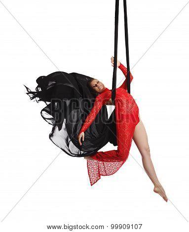 Professional dancer posing on aerial silk