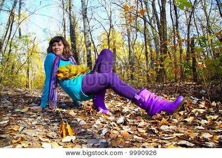 Young Girl Lying In The Autumn Fall Leaves