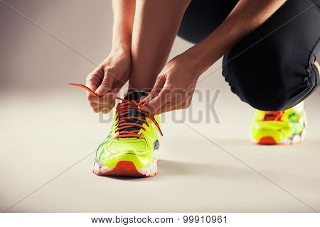 Sports. Girl tying shoelaces. Fitness