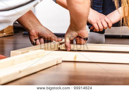 People Assembling Wood Furniture. Diy.