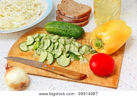 Appetizing Salad Ingredients On Kitchen Table.