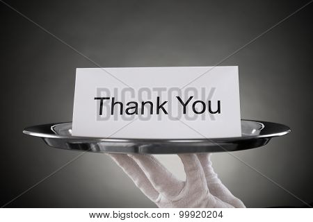 Waiter Holding Plate With The Text Thank You On Paper