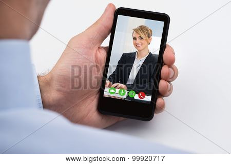Businessperson Videochatting On Mobile Phone