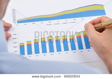 Businessperson Analyzing Graphs