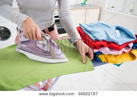 Female Hands Ironing T-shirt
