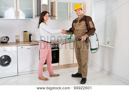 Woman And Pest Control Worker Shaking Hands