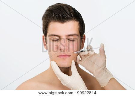 Doctor Hands Injecting Botox Injection In Man Face