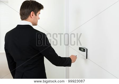 Businessman Operating Security System