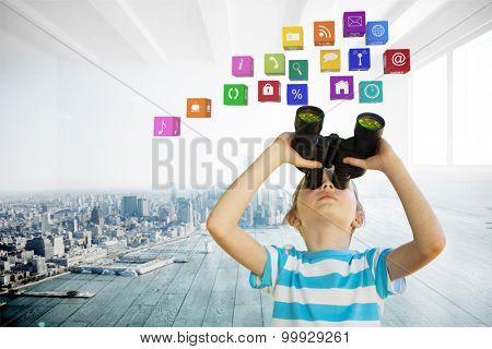 Cute little girl looking through binoculars against city scene in a room