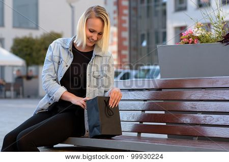 Young Woman Checking Her Purchases Or Gift