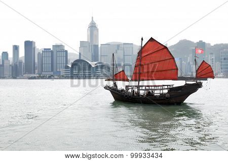Hong Kong skyline with traditional junk boat