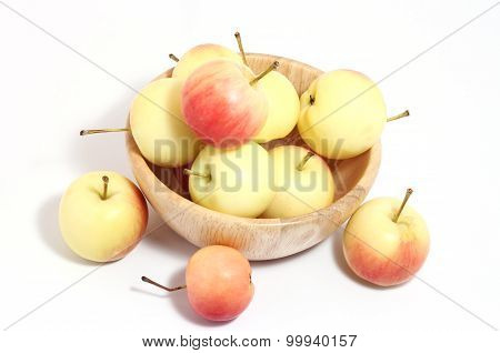 Apples In Wooden Cup Three Out.