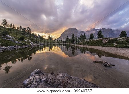 Fascinating Reflections Of The Dolomites Mountains at the Lake