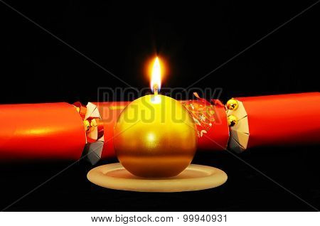 Christmas candle and cracker.