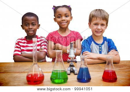 Cute pupils standing with arms crossed behind beaker against white background with vignette