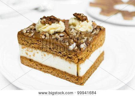 Toffee Cream Cake On White Plate