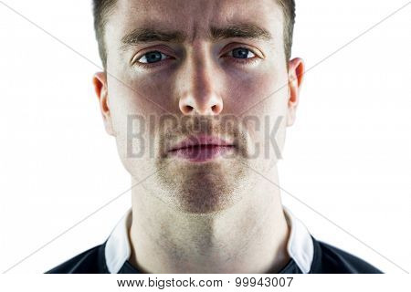Portrait of a frowning rugby player on a white background