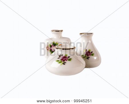 Three white porcelain flower vase with floral ornament isolated on white background