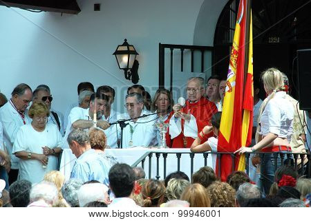 Priest giving sermon, Marbella.