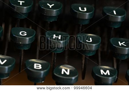 Detail closeup of old typewriter keys with dust for writing communication