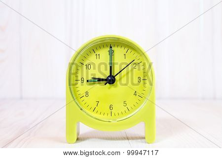 Clock On The Wood Background
