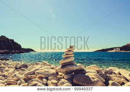 Stones Balance, Pebbles Stack Over Blue Sea In Croatia.