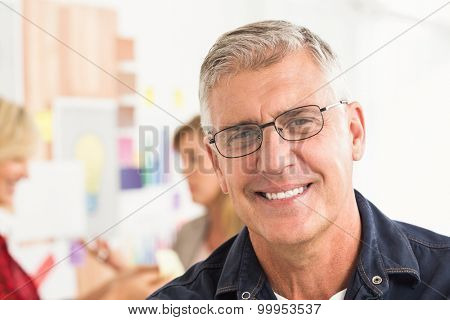 Close up portrait of a smiling businessman at office
