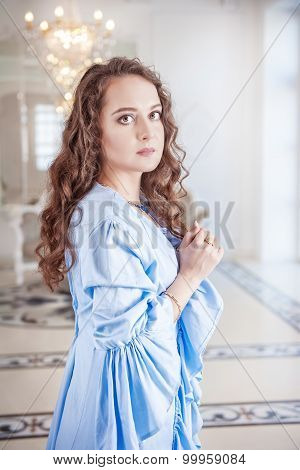 Beautiful Young Woman In Blue Dressing Gown