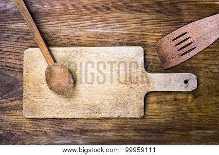 cutting board, spoon and spatula