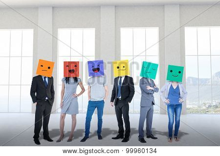 People with boxes on their heads against room overlooking ocean