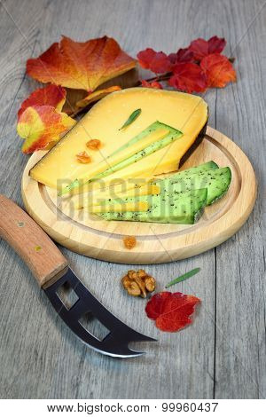 Cheese Platter: Solid Cheese And Autumn Leaves