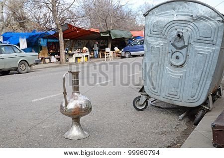 Tbilisi, Georgia - March,2 2015:Vintage pitcher on the road. Flea market in Tbilisi. Georgia
