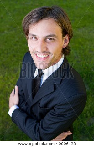 Young Businessman In Garden