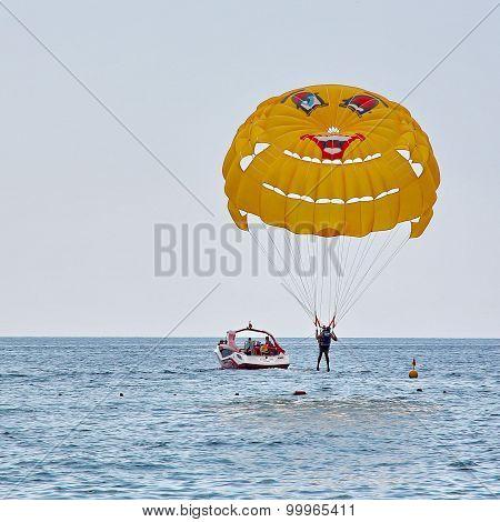 Parasailing In A Blue Sky Near Sea Beach