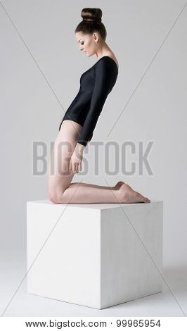 Girl standing on a cube