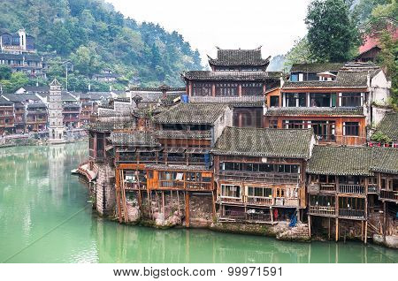 Stilt Houses On The Tuojiang River At Fenghuang Ancient Town, Hunan Province, China