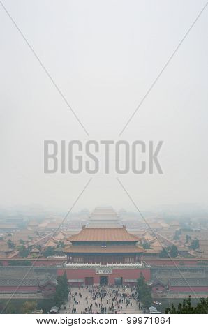 View Of The Forbidden City Through The Air Pollution, Beijing. Taken From The Top Of The Hill In Jin