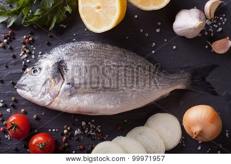 Preparation For Cooking Raw Fish Dorado With Ingredients Closeup. Top View
