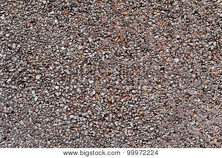 background made of a closeup of a wall plastered with a dry dash aggregates coating