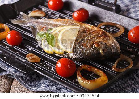 Dorado Fish With Vegetables Closeup On The Grill Pan. Horizontal