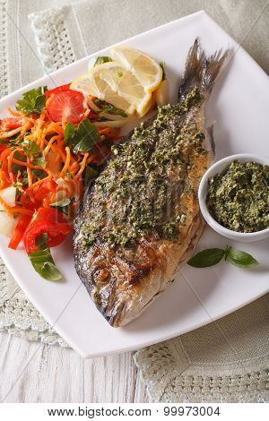 Grilled Dorado Fish With Pesto And Vegetable Salad. Vertical