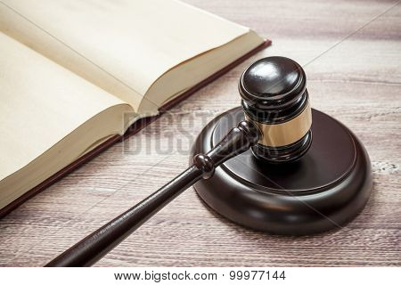 judge gavel and book on the brown wooden table, justice