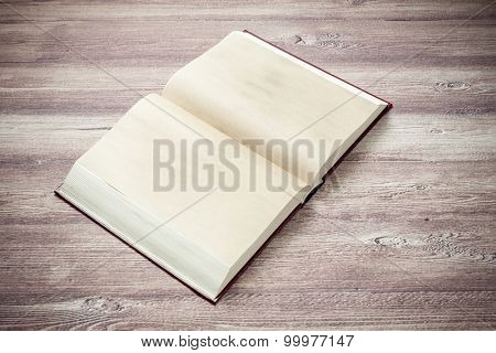Open book on the wooden table