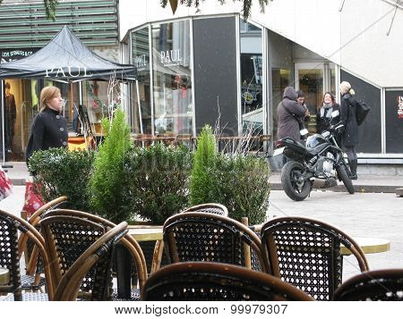Cafe with black rattan chairs outdoors